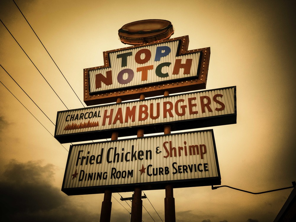 Top Notch Burgers is famous for being in the movie Dazed and Confused, which included local celeb Matthew McConaughey.  I have never seen him here.