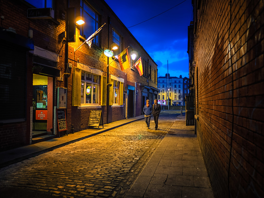 a couple meanders home through the back streets of temple bar...