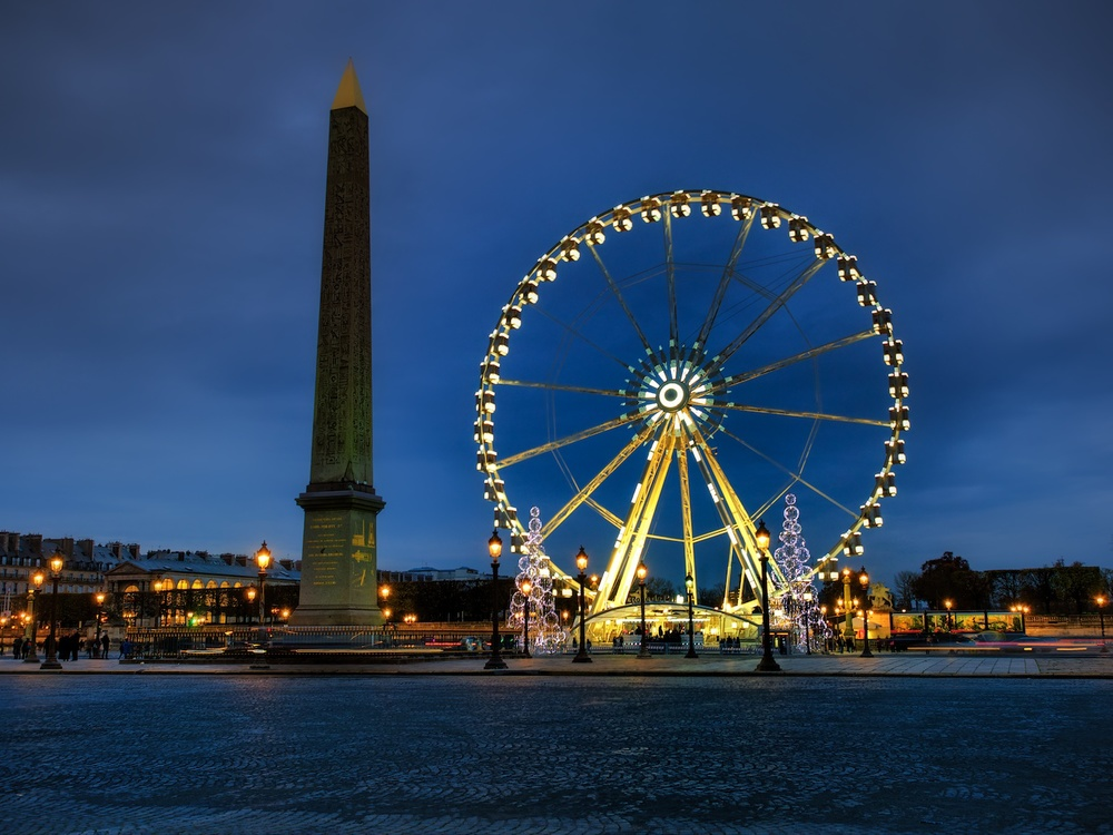 the ferris wheel and the egyptian obelisk at the place de la concorde, which is sort of near the louvre.  looks great at blue hour right?!