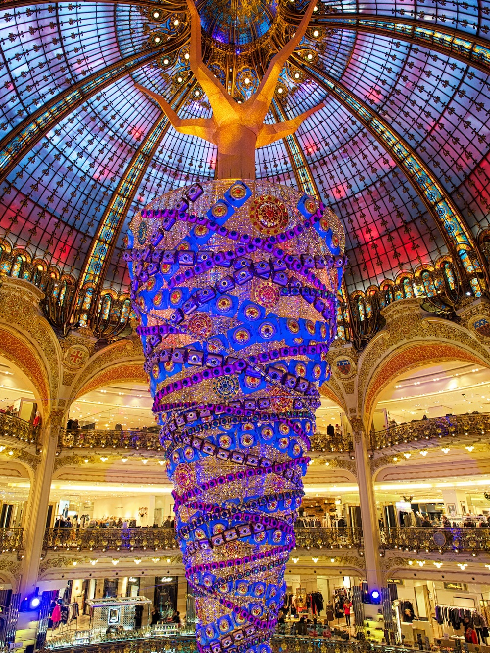 this is inside a department store known as gallerie lafayette.  basically, it's a big upside-down bejeweled christmas tree.  you don't see that everyday!