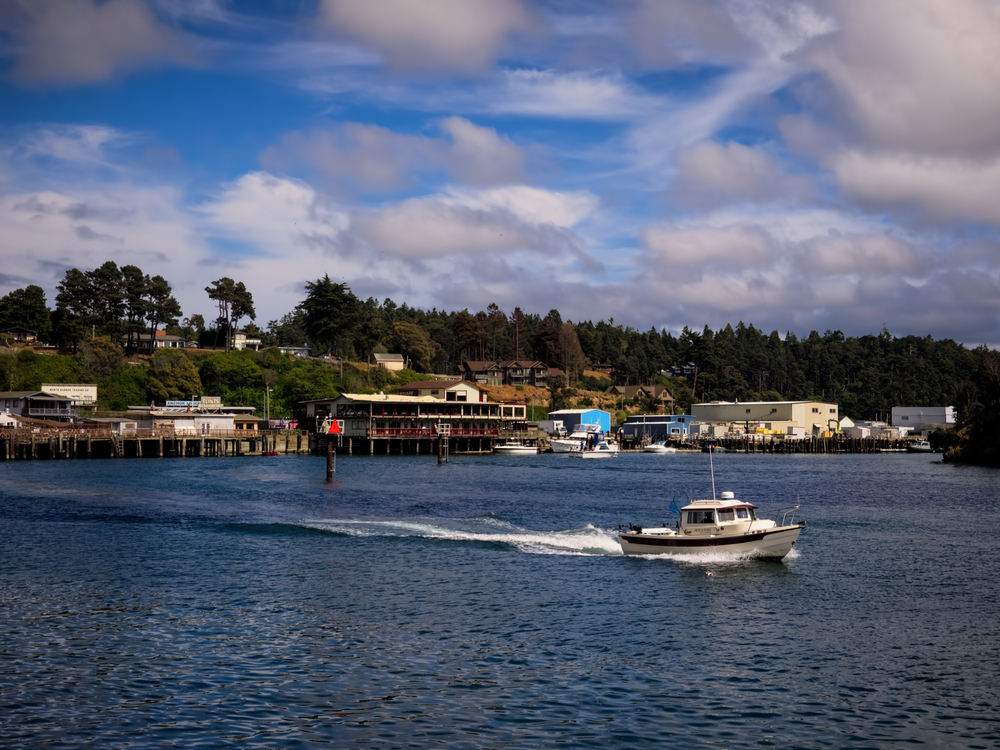A boat leaving the harbor in Fort Bragg, CA