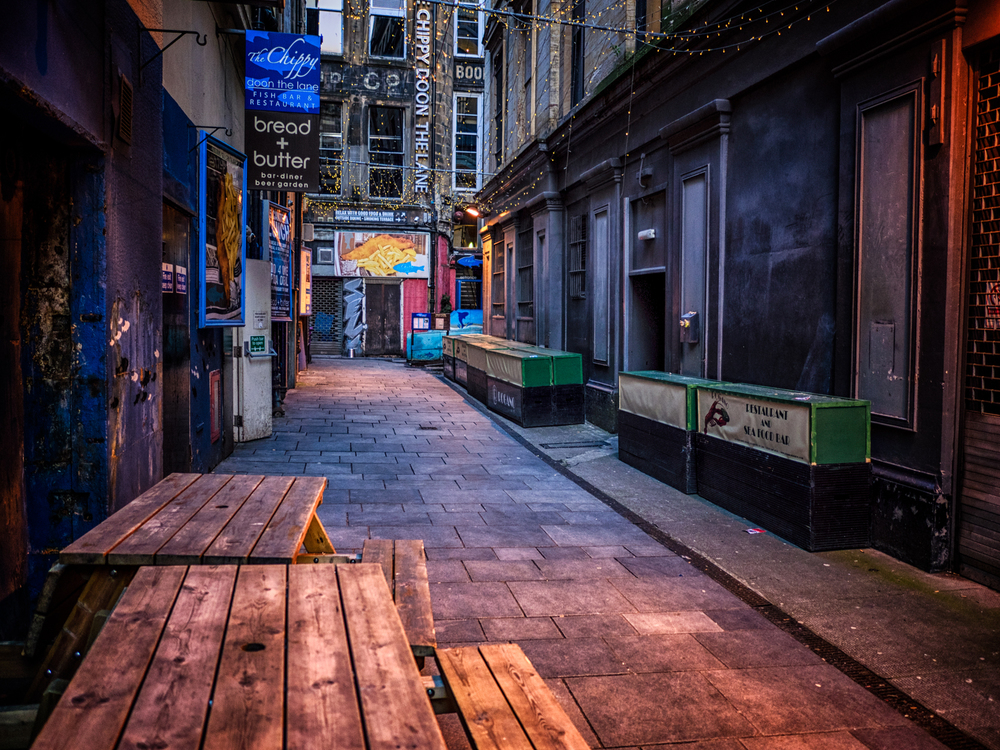 an alley that leads to a great place for fish and chips!