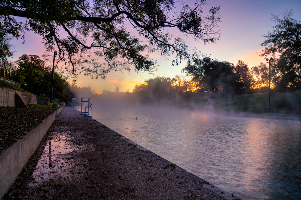 sunrise at barton springs pool - you see the swimmer out there working hard?  I loved the mist in this shot.