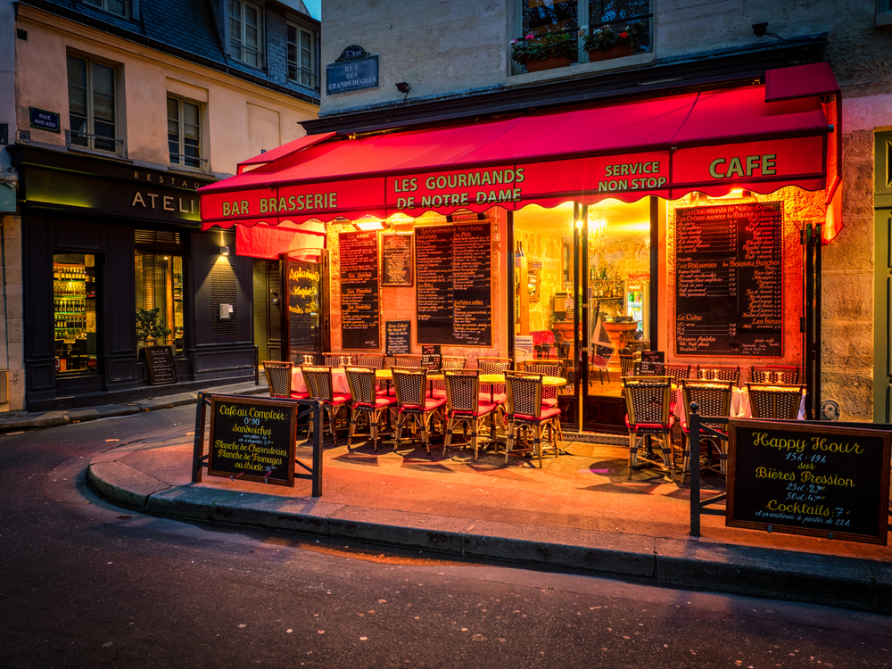a cozy little cafe near notre dame cathedral in paris, france
