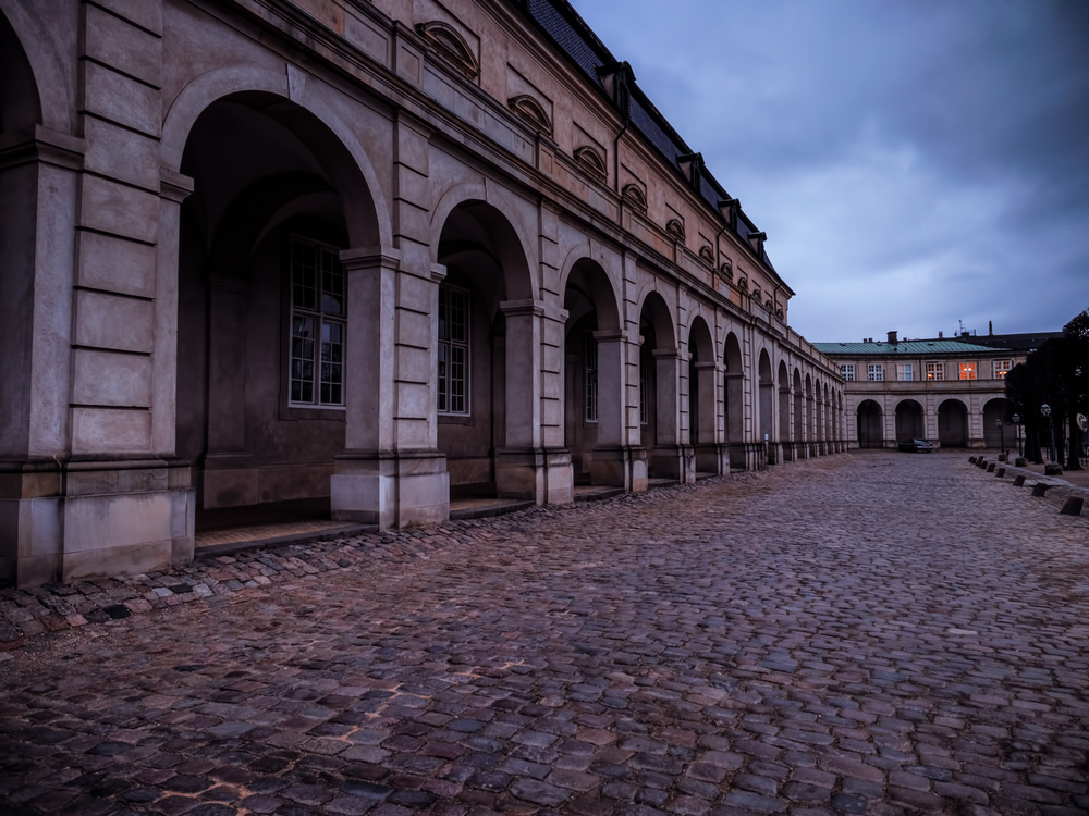 after shooting from the tower atop christiansborg palace, I wandered over here because I just love architecture.  This is part of the royal stables there.