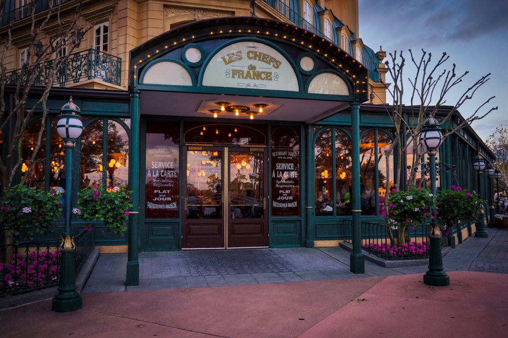 The popular Les Chefs de France restaurant in the France Pavilion at EPCOT, just after sunset.