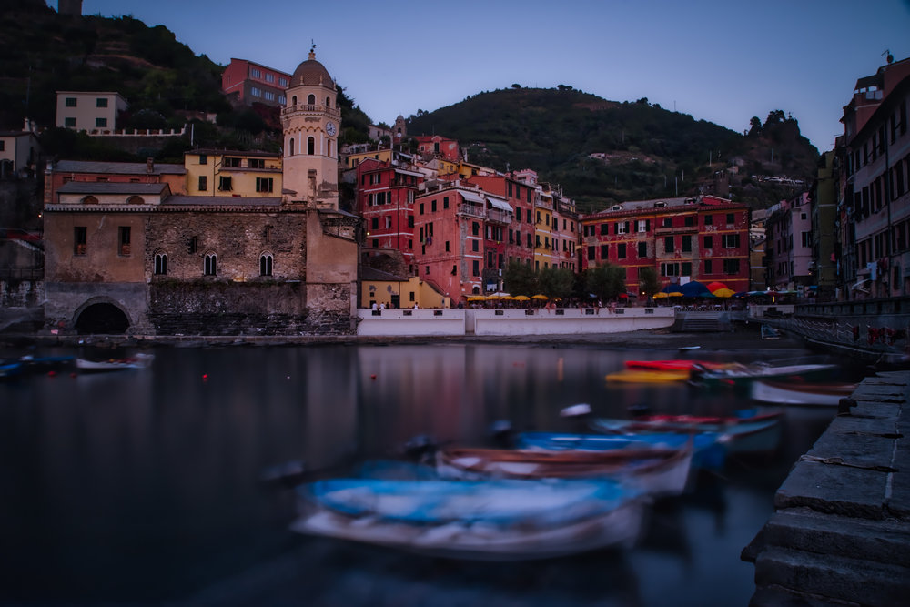 Blue hour descends on the harbor in Vernazza