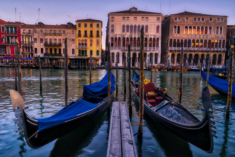 I used the gondolas to anchor the foreground while still keeping focus through the entire image and including that lovely Venetian architecture in the background.  A full frame but a beautiful one to my eyes.