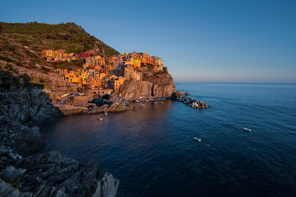Sunset begins in Manarola as I am perched high up on the trail above it.