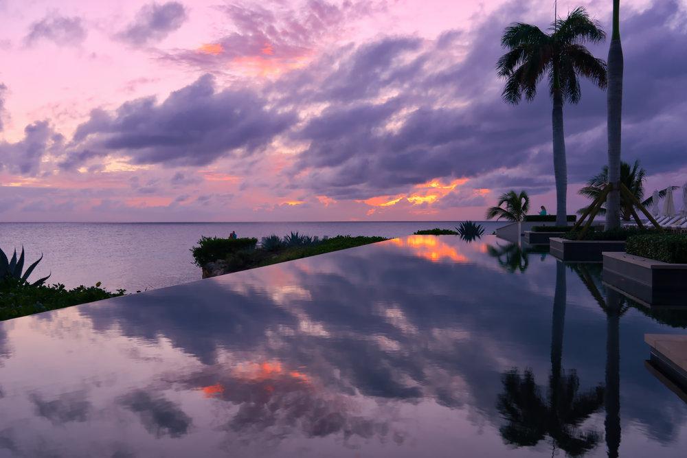 Anguilla-sunset-4seasons-pool-palm-reflect.jpg