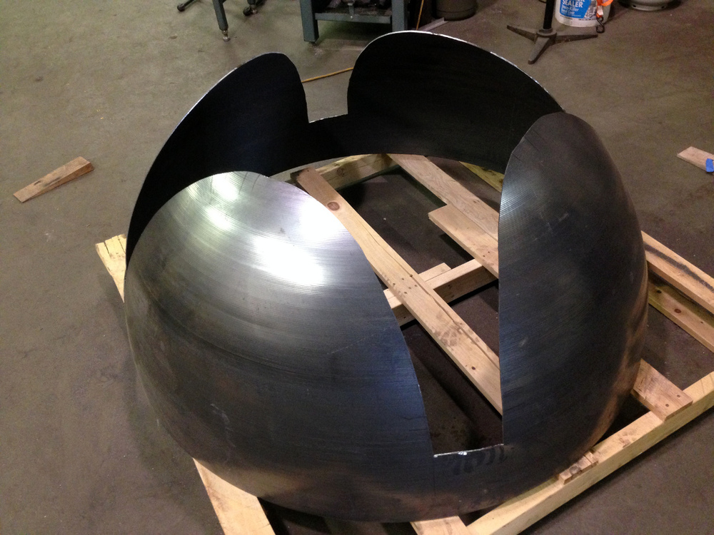 "The center part of the steel table base was cut from a 60"" diameter steel hemisphere."