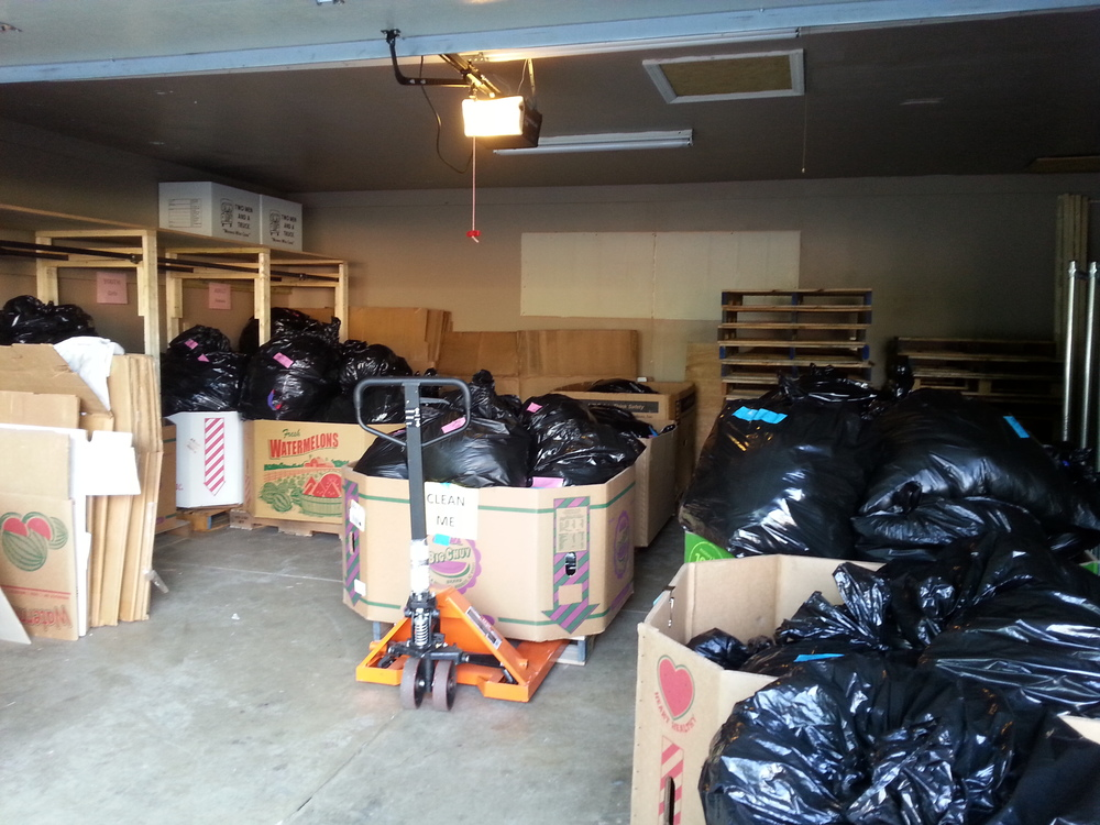 END OF PHASE II: Construction and painting complete -- now it's time to put it all back! Thank you volunteers for assembling boxes and beginning to store everything in an organized fashion! Photo of the garage after Coat Sort on Fri. 5/29