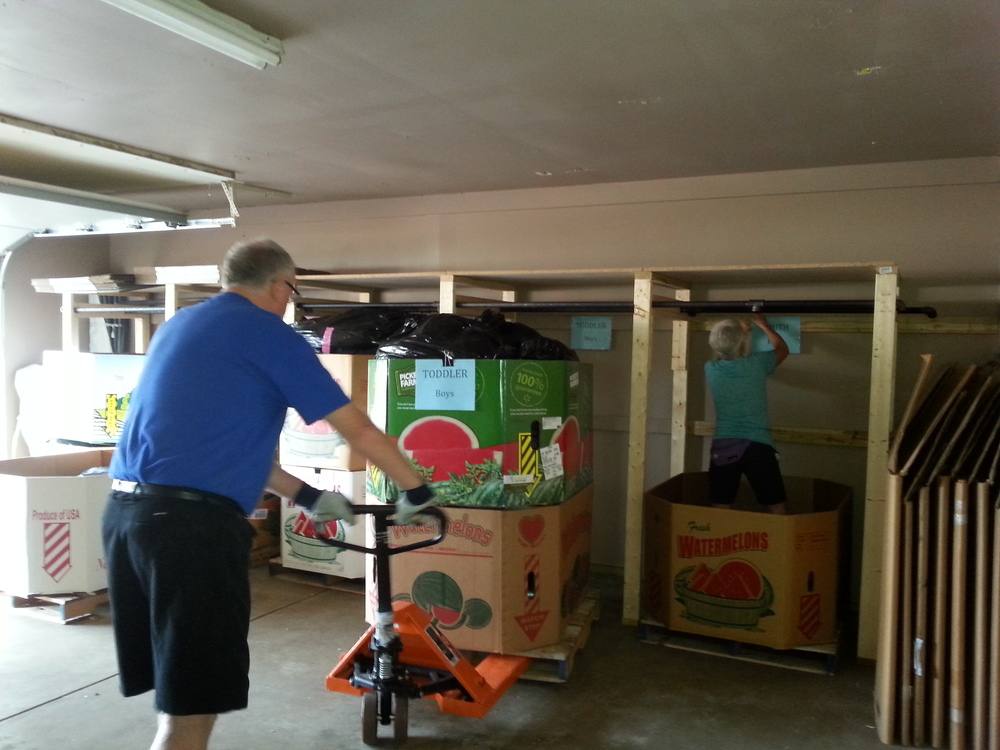 PHASE III: Reassembling the garage and organizing donations -- Moving pallets with labeled spots.