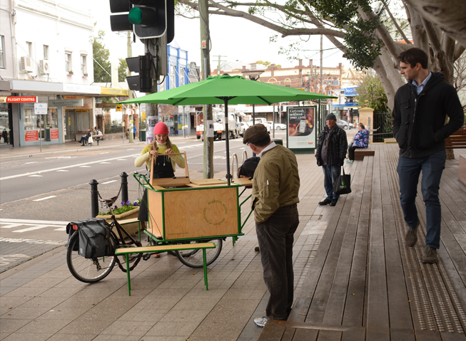Setting up the mobile workshop on the pavement of Darling St.