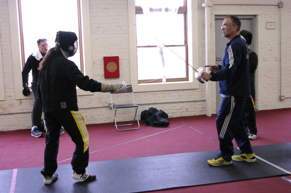 Theresa gets a couple of pointers from Bill Becker of Fencing Center of Arizona