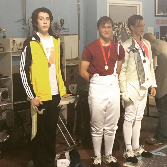 CJ with the Bronze in Y-14 Men's Saber! (Photo Credit: His mom, Kathryn Jackson)