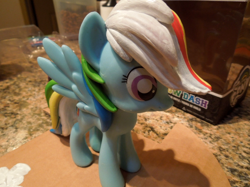 Photo shows 2 coats of acrylic gesso added on the mane and the underside of the tail.