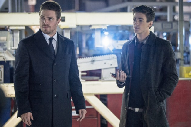 Stephen Amell as Oliver Queen (left) and Grant Gustin as Barry Allen (right)