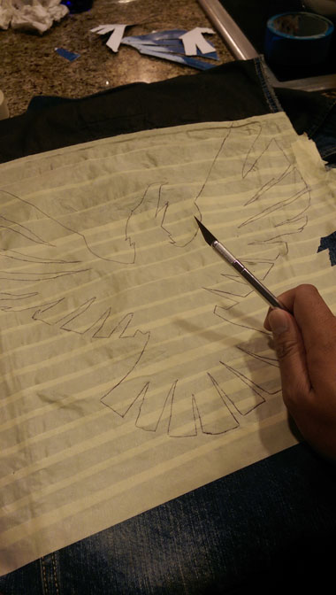 the masking tape stencil, ready to xacto the design out