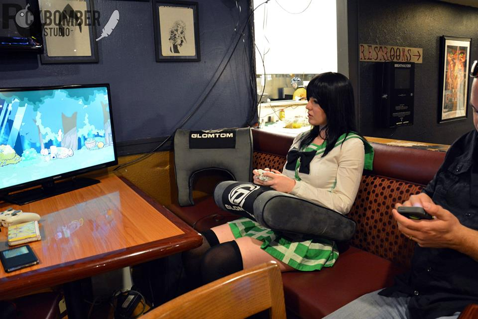 Gaming in cosplay! Checking out the Glom Tom at the Kickstarter launch party - photo by Rockbomber Studio
