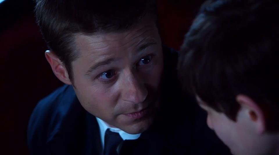 Detective Jim Gordon (Ben McKenzie) consoling a young Bruce Wayne (David Mazouz)
