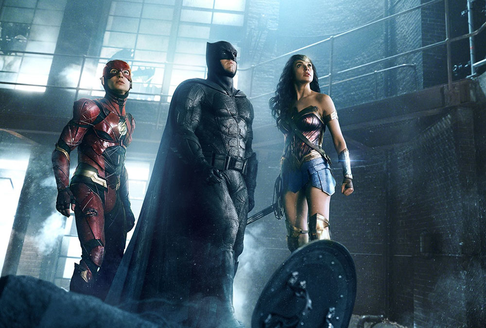 The Flash (Ezra Miller), Batman (Ben Affleck), and Wonder Woman (Gal Gadot)