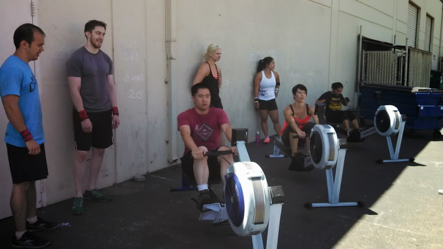Sunday's team WOD was a blast!  5K Row, 400M Overhead carry, 1200M Prowler... That is all.
