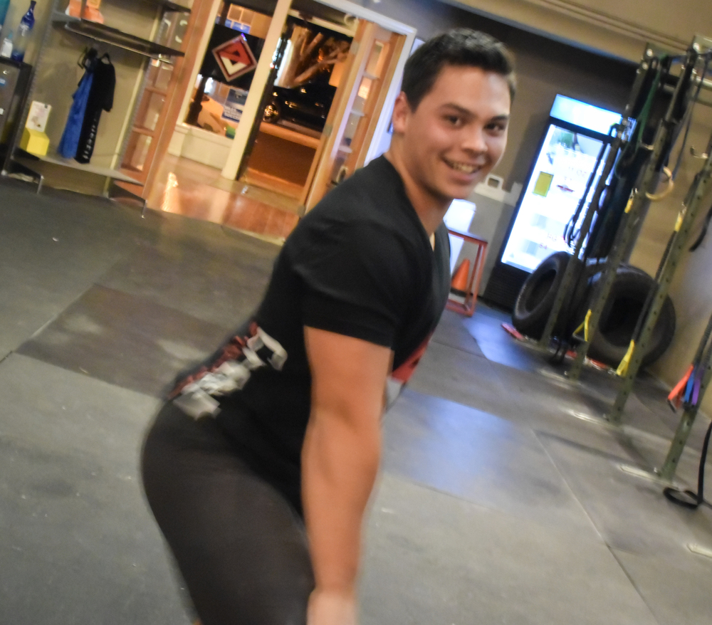 Chad properly engages his gluteals and hamstrings. Ya'll can smile while squatting, but do so facing forward- thank you.