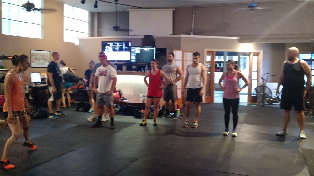 Coach Andréa warms up the 7:30PM class for the running WOD.