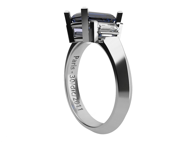 Engagement ring. 14k white gold with rhodium plating. Sapphire and diamonds
