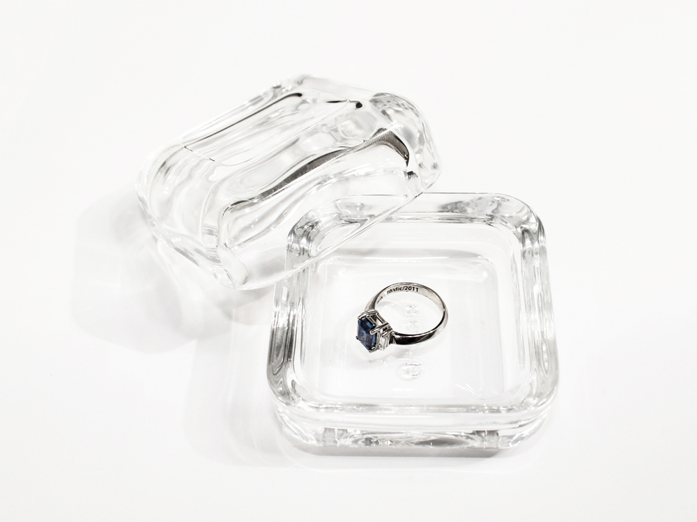 Engagement ring. 14k white gold with rhodium plating. Sapphire and diamonds. Glass box