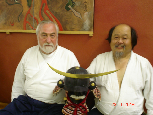 Sensei Nagahisa (r) shows off the helmet  Sensei von Krenner (l) has given him.