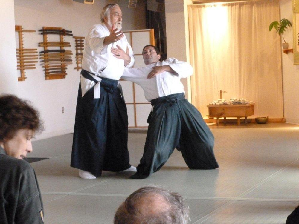 Sensei von Krenner demonstrates a variant of kote muwashi on Ken Jeremiah. Sensei Don Culp is in the foreground.