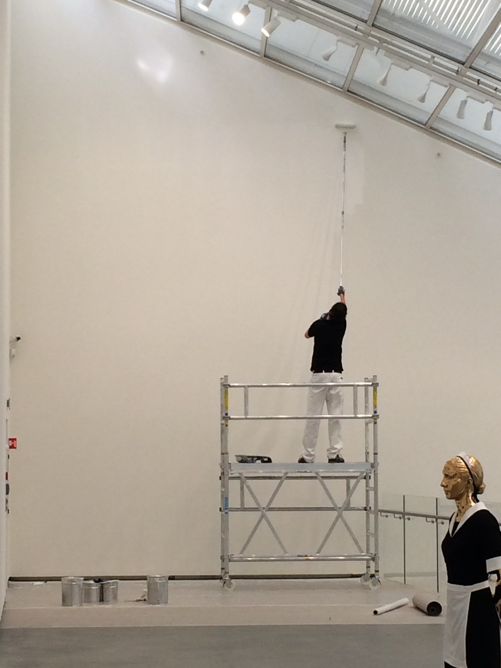"This guy was repeatedly painting the wall white as an ""installation"" or ""performance""."