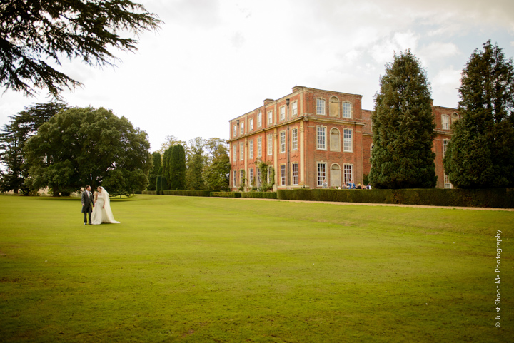 Sarah and Nick outside their wedding venue, Chicheley Hall