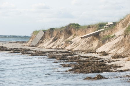 Beach erosion on Bald Head Island, North Carolina (2009).