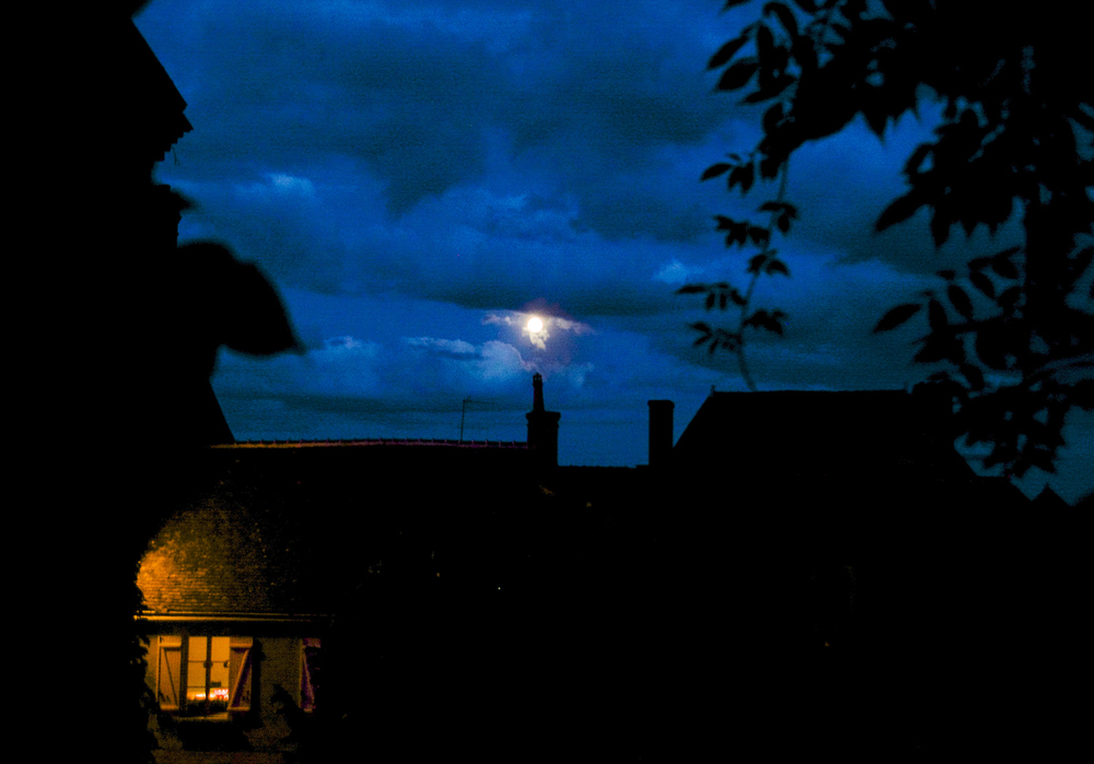 Full moon over the village...Anne and Christine's window aglow