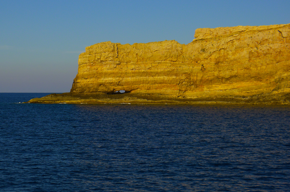 The sheer golden cliff on the most northwestern spit of land on Crete
