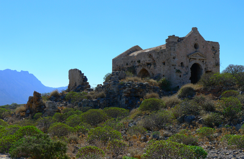 Ruins on the top of the mountain include a wall and partial structure