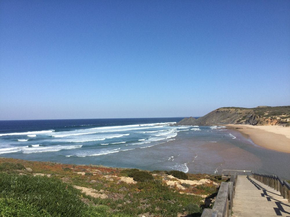 Today we drove west along the southern coast of Portugal, to visit some friends in Portimão. The western Algarve has a much more rugged coast, with no barrier islands to tame the surf. In fact this is a favorite  surfing destination.