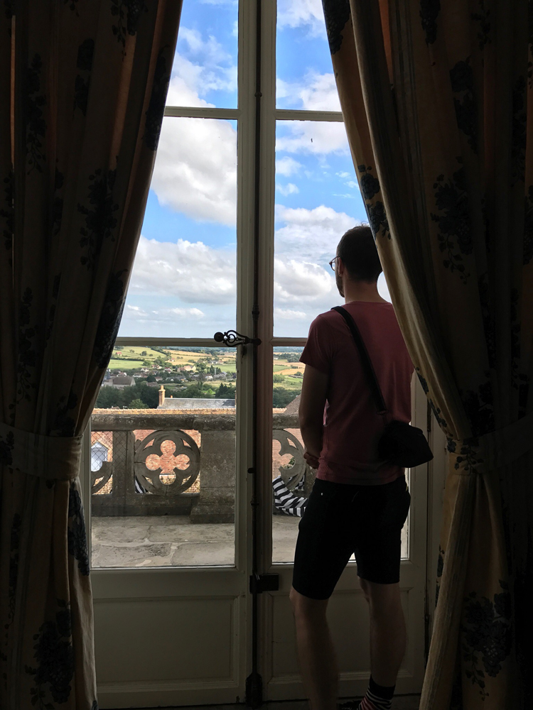 James enjoys the view from the castle. Our house is just below. - photo by Daniel Hoffmann