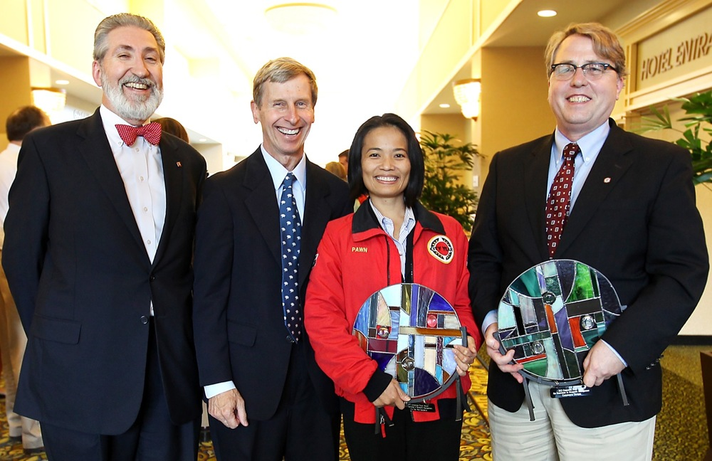(left to right) Byron Champlain, Lincoln Financial; Governor John Lynch; Pawn Nitichan, executive director, City Year New Hampshire; and Roy Gerstenberger, executive director, Community Bridges.