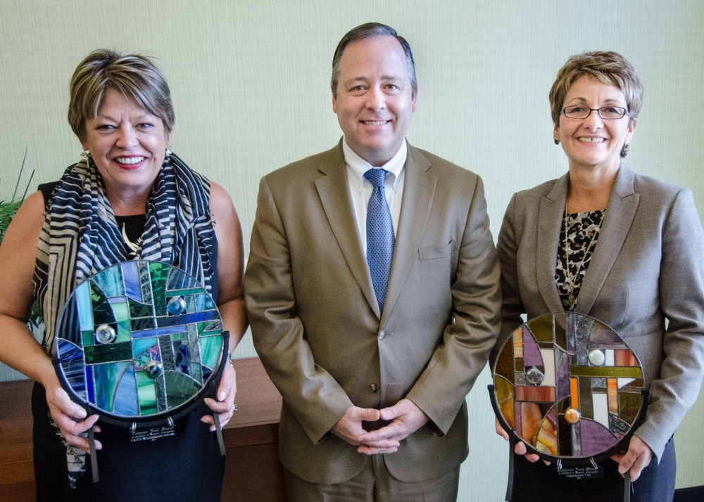 Pictured from left to right, Rosemary Heard, President of CATCH Neighborhood Housing; Joseph Murray, Vice-President of Public Affairs at Fidelity Investments; and Julie Reynolds, Chief Exective Officer of Cornerstone VNA. The Excellence in Nonprofit Management Award was presented during the NH Nonprofit Leadership Summit at the Grappone Conference Center on September 19, 2014. Awards were hand-made by Susanna Ries of Mount Vernon, NH. Photo Credit Jeffrey Hastings.