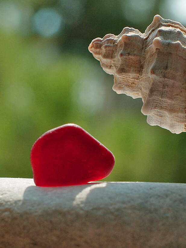 A perfect piece of ruby red sea glass that I found last week in Paros Island, Greece