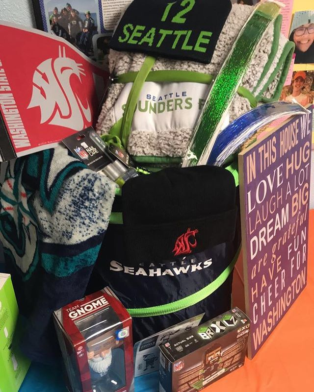 Raffle tickets are being sold all this week, through the event this Saturday! But you don't have to be present to win! If you love sports this, basket is for you, with merch from all your favorite PNW teams! The PNW sports basket has a minimum value of $250! You could win it for only $5!