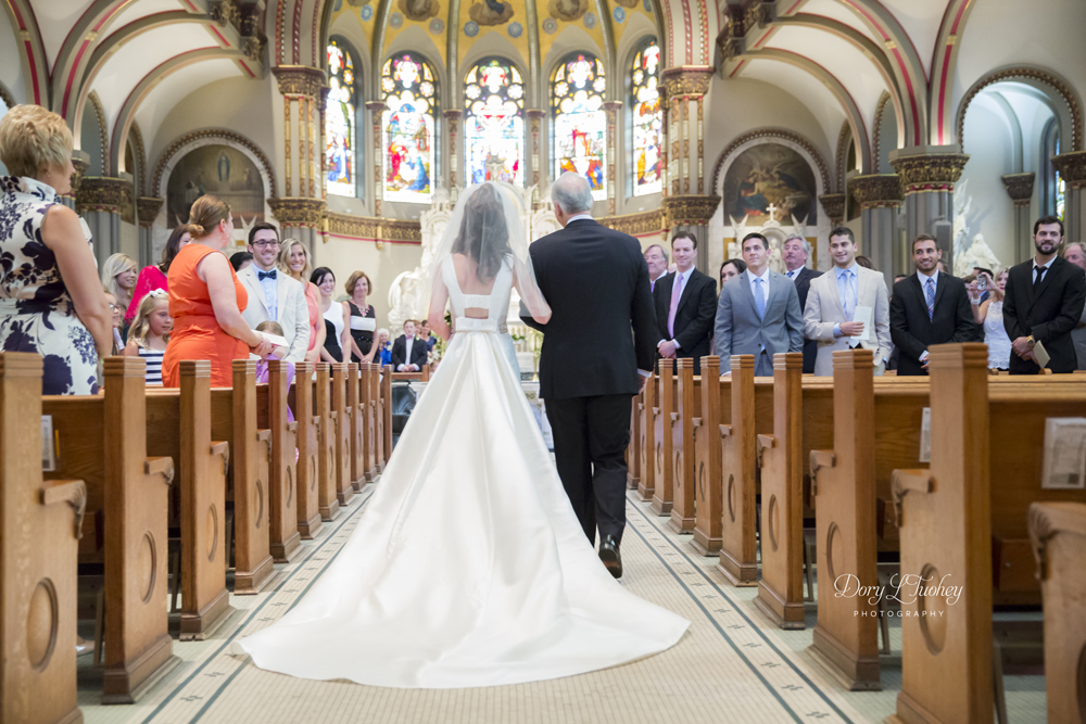 A great shot of Kate walking up the aisle by Rio.