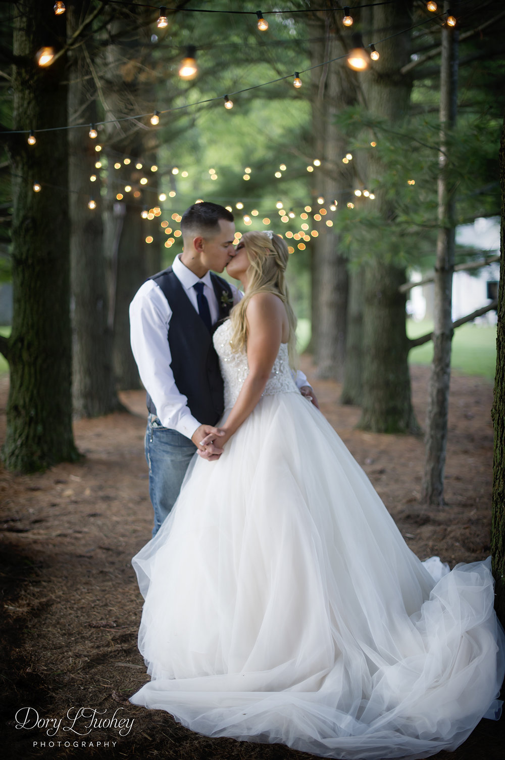 Dory_wedding_oak_hill_galena_farm_horses_field_bride_tulle_photographer_light_pine_tree_kiss_love_groom_twinkle_02.jpg