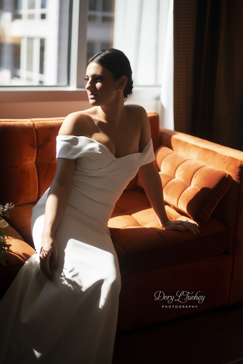 Conrad_hotel_chicago_bride_wuite_wedding_BHLDN_orange_sofa_gorgeous_natural_light_dory_tuohey_photographer.jpg