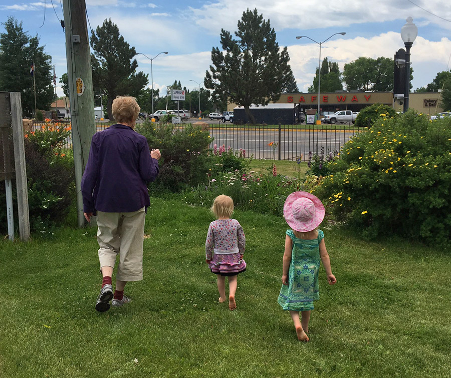 My mom doing what she does best... spending time with her granddaughters. This day we were exploring flowers at the local park.