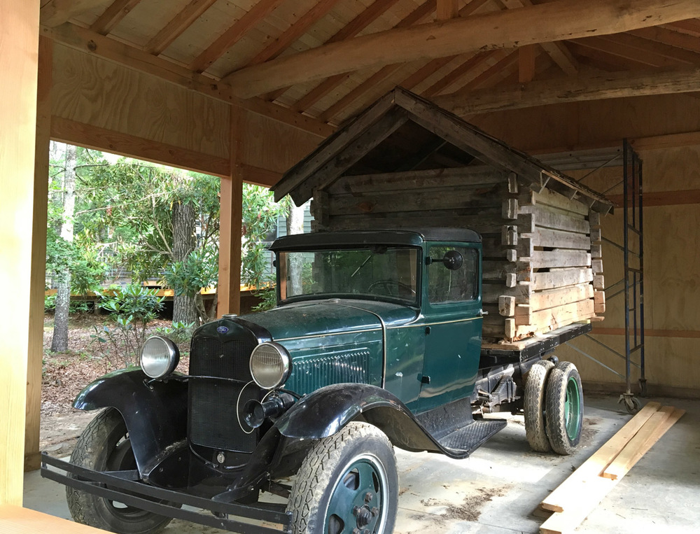 "Penland's current-day replica of Lucy Morgan's 1933 truck and ""tiny house"" for the Chicago World's Fair. Housed in a post and beam structure made by a class in 2016."